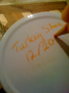 Using a grease pencil to label a jar lid
